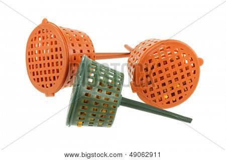 Close up photo of Slow-release Fertilizer Baskets, They are not water-soluble and they reduce fertilizer burn