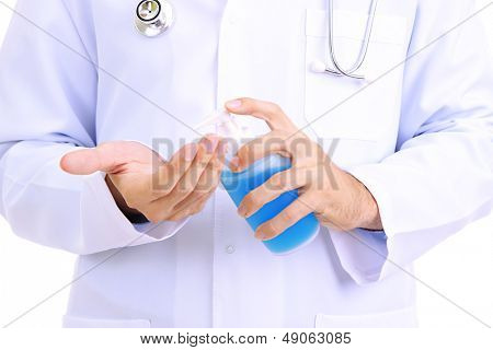 Medical doctor using sanitizer dispenser
