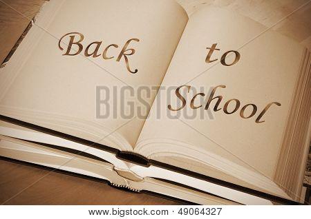 sentence back to school written in an open book on a desk