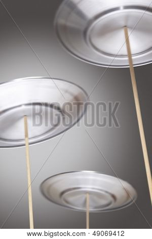 Plates Spinning on Sticks