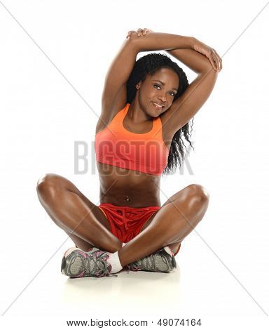 Young Black Woman working out and stretching isolated on a white background