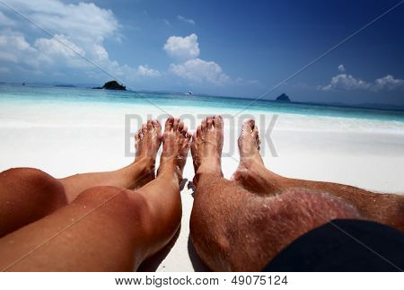 Couple relaxing on a tropical beach