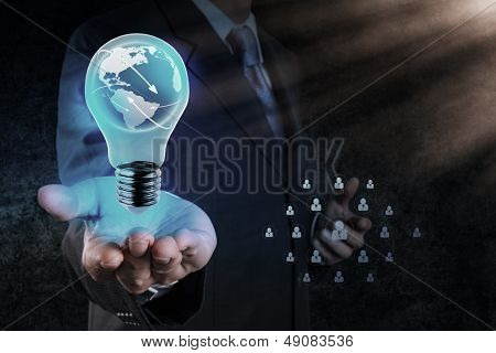 Businessman's Hand Shows Light Bulb With Planet Earth as a Social Network