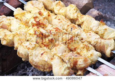 Shish Kebab On The Improvised Oven Made Of Brick. Barbecue Grill Meat In Cooking Process.