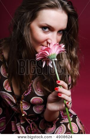 Woman Sniffing A Flower