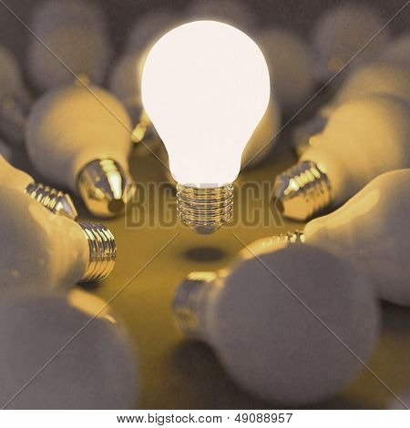 Growing Light Bulb Standing Out From The Unlit Incandescent Bulbs As Leadership Concept