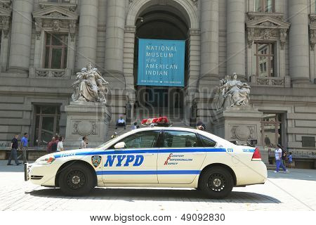 NYPD car in the front of National Museum  of the American Indian in Manhattan