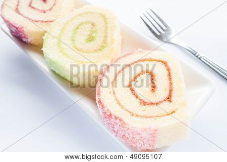 Set Of Colorful Jam Roll Cakes With Fork