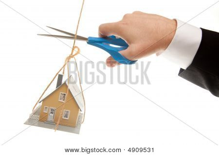 Hand With Scissors Cutting String Holding House