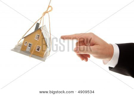 Swinging House And Business Man's Hand Reaching