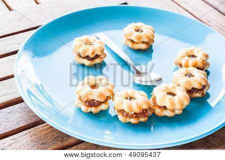 Smiling Face Of Pineapple Biscuits On Wood Table