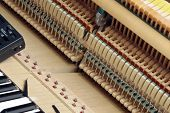 picture of tuning fork  - Upright Piano during tuning.Horizontal image orientation. Please see my other photos of a piano being tuned: - JPG