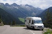 image of camper-van  - Motorhome driving up a mountain range on vacation - JPG