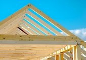 image of rafters  - Rafters of the roof frame of a house under construction - JPG