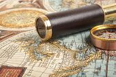 Vintage brass telescope on antique map