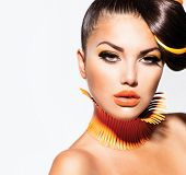 stock photo of makeover  - Fashion Model Girl Portrait with Yellow and Orange Makeup - JPG