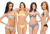 summer, bikini and fashion concept - group of model girls in bikinis