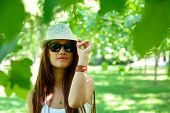 image of fedora  - fashion girl outdoor portrait - JPG