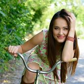 stock photo of adolescent  - Happy young beautiful woman with retro bicycle - JPG