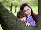 foto of niece  - Beautiful Mother and Daughter Resting on a Tree as they Enjoy Nature - JPG