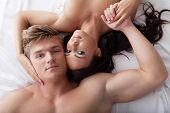 picture of foreplay  - Portrait of young hugging lovers posing in bed - JPG