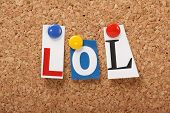image of jargon  - LOL the abbreviation for Laugh Out Loud in cut out magazine letters pinned to a cork notice board - JPG