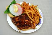 stock photo of mahi  - blackened mahi mahi fish sandiwch and a french fries on a plate - JPG