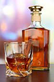 stock photo of whiskey  - Glass of whiskey with bottle - JPG