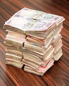 pic of dowry  - Stack of Indian rupees on a table - JPG