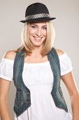 image of girl next door  - Young blond woman dressed in black hat and casual jeans clothes with  - JPG