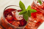 picture of hibiscus  - Cold Refreshing Berry Hibiscus Iced Tea with Mint - JPG