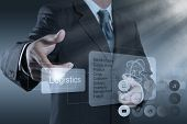 stock photo of logistics  - businessman hand shows logistics diagram as concept - JPG