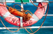 stock photo of tromso  - Lifebuoy on a ferry at sea background - JPG