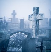stock photo of headstones  - Cemetery in fog - JPG