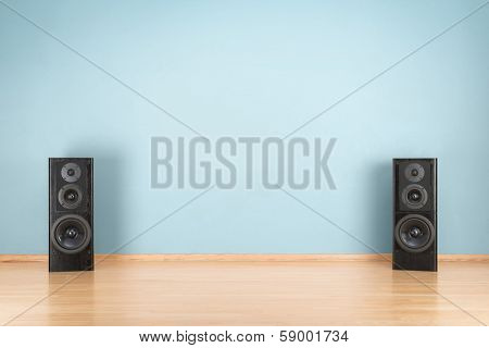 Black audio speakers on the floor