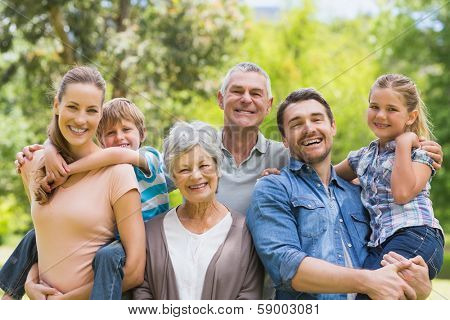 Portrait of an extended family smiling at the park