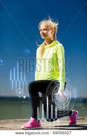 sport and lifestyle - young sporty woman with light dumbbells outdoors
