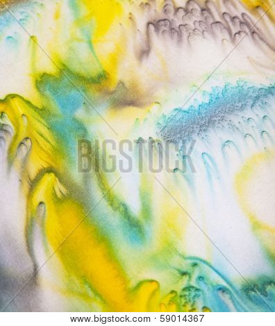 Close up view of silk scarf with abstract pattern
