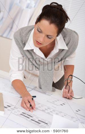 Female Architect Watching Plans