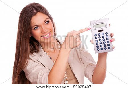 Beautiful young business woman showing with index finger on calculator