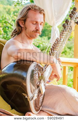 Man Playing On Indian Traditional Musical Instument - Sitar