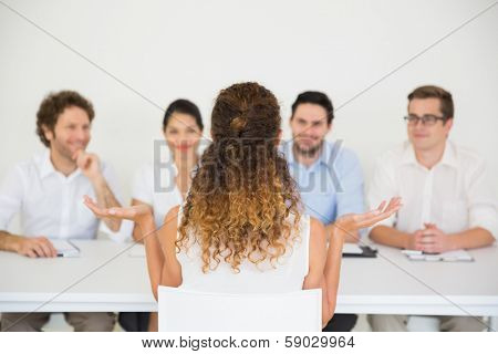 Female candidate having an interview in office