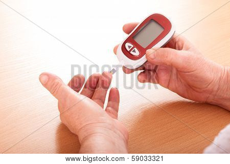 Woman makes testing  high blood sugar.