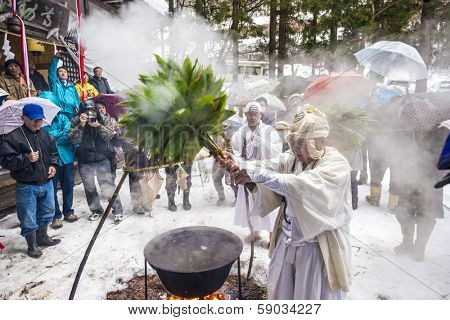 NAGANO, JAPAN - FEB 4, 2013: Shinto Ascetics perform ancient purifying rites. Known as Yamabushi, they are mountain hermits with a long tradition of mysticism.