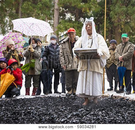 NAGANO, JAPAN - FEB 4, 2013: Shinto Ascetics firewalk during a Shinto ritual. Known as Yamabushi, they are mountain hermits with a long tradition of mysticism.