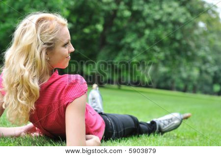 Young Woman Relaxing After Roller Skating