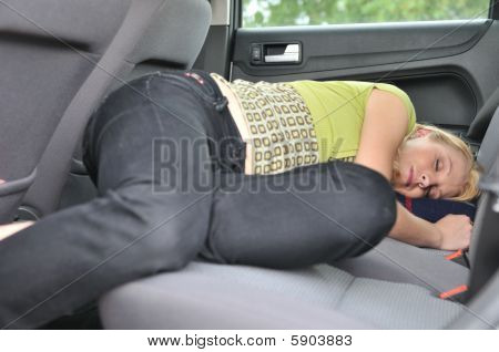 Young Woman Sleeps In Car