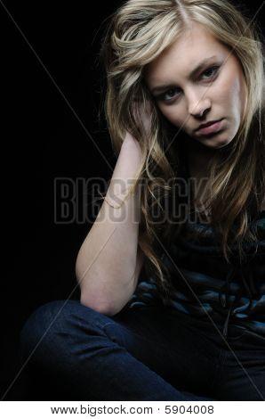 Depressed Teenager On Black