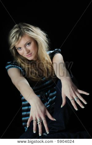Young Woman Showing Hands With Rings And Gel Nails