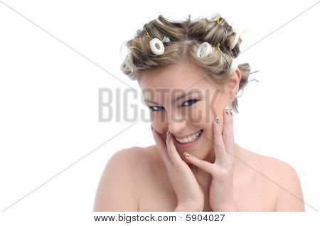 Young Beautiful Happy Woman With Hair Rollers